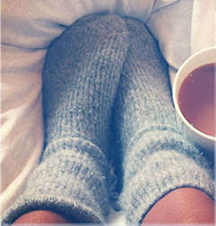 Cosy picture of winter socks with a hot drink.